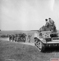 German troops surrender to British crew of a Stuart tank near Frendj, 6 May 1943.
