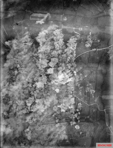 The town of Villers-Bocage, photographed during the bombing raid on 30 June 1944. Six Avro Lancasters are visible.