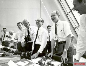 Charles W. Mathews, von Braun, George Mueller, and Lt. Gen. Samuel C. Phillips in the Launch Control Center following the successful Apollo 11 liftoff on July 16, 1969.