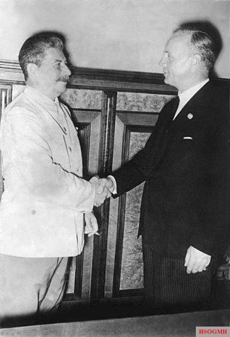Stalin and Ribbentrop shaking hands after the signing of the pact on August 23, 1939.