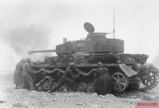 A German tank crew attempts to restore their Panzer IV's mobility after battle damage inflicted during the fighting.