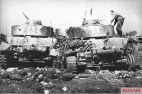 Two destroyed Panzer IV tanks belonging to the 20th Panzer Division, June 1944.