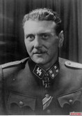 SS-Sturmbannführer der Reserve Dipl.-Ing. Otto Skorzeny (Kommandeur Sonderverband z.b.V. Friedenthal) in a studio portrait after he received the Ritterkreuz des Eisernen Kreuzes (directly from Adolf Hitler) in 13 September 1943, a day after the successful operation to liberate Italian dictator Benito Mussolini from his prison hotel in Gran Sasso, Italy. In the same day, Skorzeny got promoted from SS-Hauptsturmführer d.R. to SS-Sturmbannführer d.R. Note that this picture had been edited before, - in the kragenspiegel and schulterklappen - and the edited version had been circulated not long after this picture was taken!