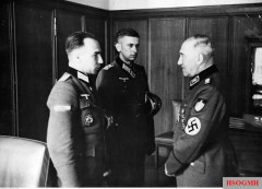 12 June 1943: Reichsarbeitsführer Konstantin Hierl (Leiter des Reichsarbeitsdienst, RAD), right, in conversation with two Ritterkreuzträger from RAD who served in the Wehrmacht. From left to right: Hauptmann der Reserve Rudolf Kreitmair (Ritterkreuz in 31 March 1943 as Führer 7.Kompanie / II.Bataillon / Grenadier Regiment 282 / 98.Infanterie-Division) and Oberleutnant der Reserve Günter Vollmer (Ritterkreuz in 20 April 1943 as Führer 3.Kompanie / I.Bataillon / Grenadier-Regiment 411 / 122.Infanterie-Division). The picture was taken by Kriegsberichter Barthold.