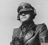 """SS-Sturmbannführer Gerhard """"Gerd"""" Bremer (Kommandeur SS-Panzeraufklärungs-Abteilung 12 / 12.SS-Panzer-Division """"Hitlerjugend"""") photographed in 3 March 1944 during a military drill with Hitlerjugend Division at the Beverloo Training Ground, Belgium. He was awarded the Knight's Cross for outstanding leadership during the initial phase of the Operation Barbarossa with Leibstandarte Division and on 26 November 1944 the Oak Leaves with Hitlerjugend Division."""