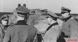 "A Sd.Kfz. 251/16 fitted with flame projectors from 12. SS Panzer Division Hitlerjugend being inspected by officers at the Beverloo Training Ground, Belgium in 3 March 1944. From left to right: SS-Sturmbannführer Gerhard Bremer (Kommandeur SS-Panzeraufklärungs-Abteilung 12 / 12.SS-Panzer-Division ""Hitlerjugend""), Generalfeldmarschall Gerd von Rundstedt (Oberbefehlshaber West), SS-Obergruppenführer und General der Waffen-SS Josef ""Sepp"" Dietrich (Kommandierender General I. SS-Panzerkorps), SS-Obersturmbannführer Wilhelm Mohnke (Kommandeur SS-Panzergrenadier-Regiment 26 / 12.SS-Panzer-Division ""Hitlerjugend"")."