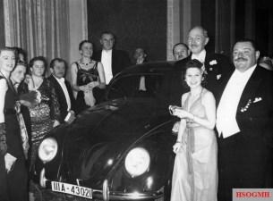 German Press Ball 1939. Dr. Ferdinand Porsche presents the Volkswagen tombola prize to Mrs. Elsa Ellinghausen, the lucky winner.