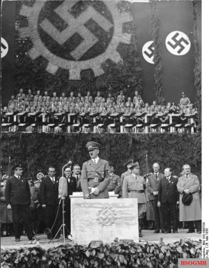Adolf Hitler laying the foundation stone of the KDF-Wagen (Volkswagen) factory near Fallersleben (Wolfsburg) on 26 May 1938. Ferdinand Porsche at far right.