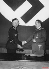 Heinrich Himmler and Hermann Göring at the meeting to formally hand over control of the Gestapo in Berlin, 1934.