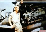 Two technicians of I.Gruppe / Jagdgeschwader 52 (JG 52) working on the piston engine of the unit's Messerschmitt Bf 109G-6.