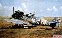 "At Kharkov-Roganj, a day-fighter of 1.Staffel / I.Gruppe / Jagdgeschwader 52 (JG 52) awaits further action. This Messerschmitt Bf 109 G-6 ""White 10"" (s/n 19881) was flown by Leutnant Willmann in summer of 1943."
