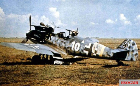 """At Kharkov-Roganj, a day-fighter of 1.Staffel / I.Gruppe / Jagdgeschwader 52 (JG 52) awaits further action. This Messerschmitt Bf 109 G-6 """"White 10"""" (s/n 19881) was flown by Leutnant Willmann in summer of 1943."""