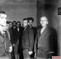 German Gestapo agents arrested after the liberation of Liège, Belgium, are herded together in a cell at the Citadel of Liège, October 1944.