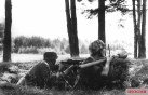 Finnish soldiers in a foxhole. One of the soldiers is holding a Panzerfaust.