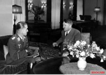25 September 1940 : Major Adolf Galland (Geschwaderkommodore Jagdgeschwader 26) chats with Adolf Hitler after Galland received the Ritterkreuz des Eisernen Kreuzes mit Eichenlaub (Knight's Cross of the Iron Crosses with Oak Leaves) directly from the Führer at Reichskanzlei, Berlin/ Galland was the third person who received the coveted medal after Eduard Dietl and Werner Mölders.