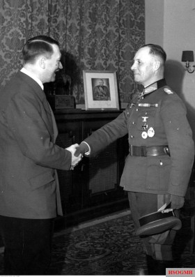 Award ceremony in Reichskanzlei, Berlin, 25 March 1941: Adolf Hitler (Führer und Reichskanzler) decorates Generalleutnant Erwin Rommel (Kommandeur 7. Panzer-Division) with Ritterkreuz des Eisernen Kreuzes mit Eichenlaub #10 (Knight's Cross with the Iron Crosses Nr.10). The man in the picture is Hitler's closest ally, Benito Mussolini.