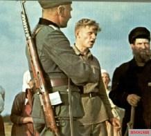 German soldier with captured SVT-40 Soviet rifle.
