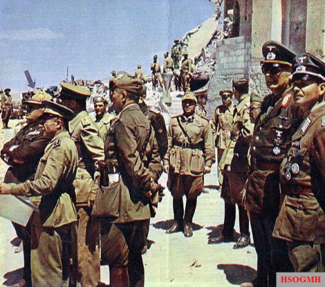 "In the summer of 1942, Il Duce Benito Mussolini (marked with arrow) visits Tobruk, Libya, not long after its recaptured from the Commonwealth forces by ""The Desert Fox"" Erwin Rommel."