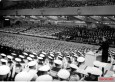 "Hitlerjugend demonstration under the banner of ""Die Ritterkreuzträger der Kriegsmarine Rede an die Hitlerjugend"" (The Knight's Cross Recipients of the German Navy Speech to the Hitler Youth) at the Berlin Sportpalast, 16 June 1943. Kapitänleutnant Reinhard Hardegen at the podium. He receives the Ritterkreuz des Eisernen Kreuzes on 23 January 1942 and Eichenlaub #89 on 23 April 1942, both as Kommandant of U-123."