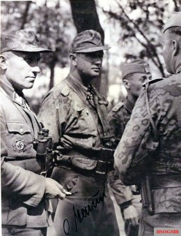 """SS-Brigadefuhrer Hermann Prieß (left, shortly after his promotion) and SS-Obersturmbannführer Otto Baum (in SS Tarn) during the battle at Kursk in July 1943; The 4th Panzer Army under Hermann Hoth included the II. SS Panzer Corps under Obergruppenfuhrer Paul Hausser with the three Panzergrenadier divisions """"Leibstandarte SS Adolf Hitler"""", """"Das Reich"""" and """"Totenkopf""""."""