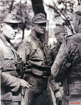 "SS-Brigadefuhrer Hermann Prieß (left, shortly after his promotion) and SS-Obersturmbannführer Otto Baum (in SS Tarn) during the battle at Kursk in July 1943; The 4th Panzer Army under Hermann Hoth included the II. SS Panzer Corps under Obergruppenfuhrer Paul Hausser with the three Panzergrenadier divisions ""Leibstandarte SS Adolf Hitler"", ""Das Reich"" and ""Totenkopf""."