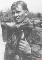 Waffen SS soldier with shouldered machine gun.