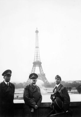Hitler in Paris in 1940 with Speer (left), and sculptor Arno Breker.
