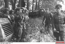 Generalfeldmarschall Erwin Rommel inspects the 21st Panzer Division in May 1944.
