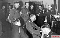 Generaloberst Rudolf Schmidt (Oberbefehlshaber 2. Panzerarmee) playing piano at his farewell party in Orjol, Russia, 4 March 1943.