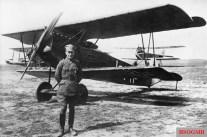 """Ernest Udet beside his Fokker DVII nicknamed """"Lo""""."""