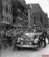 Adolf Hitler at the SA parade in Nuremberg, September 1935. Franz Pfeffer von Salomon and Hermann Göring stand to the left; SS-Sturmbannführer Jakob Grimminger stands behind the car.