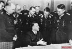 Von Greim second on the left behind Hitler, 1945.