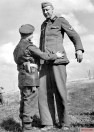 Obergefreiter Nacken surrenders to the British Corporal Bob Roberts at Calais, end of September 1944.