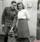 SS-Sturmbannführer Gerhard Bremer with his wife Almut and her German Shepherd.
