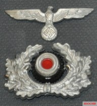 Eagle/swastika and wreathed cockade used on the peaked cap.