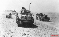 The Panzerjäger-Abteilung 39 part of Kampfgruppe Gräf, from the 21st Panzer Division of the Afrika Korps on the move. The vehicles are a Sd.Kfz. 231 8-rad and motorcycle sidecar combination.