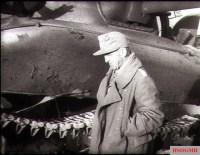 Major Johannes Kümmel inspecting the destroyed U.S. Sherman tank after the Battle of Kasserine Pass.