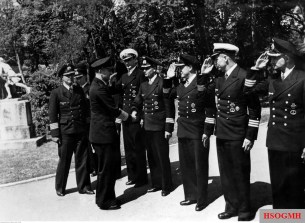 September 1943: Großadmiral Karl Dönitz, accompanied by Kapitän zur See Hans Rudolf Rösing, greets U-boat commanders and Flottillenchef decorated with the Ritterkreuz des Eisernen Kreuzes (Knight's Cross of the Iron Crosses). From left to right: Fregattenkapitän Ernst Kals, unidentified (blocked by Dönitz), Korvettenkapitän Klaus Scholtz, Korvettenkapitän Georg-Wilhelm Schulz shaking hands with Dönitz, Korvettenkapitän Werner Winter, Korvettenkapitän Heinrich Lehmann-Willenbrock, and Korvettenkapitän Günter Kuhnk.