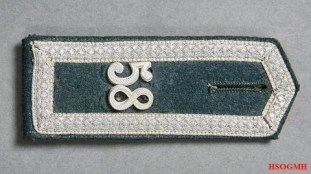 Shoulder straps with pointed ends.