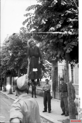 Woman hanged by the Fascists in Rome. On the skirt there is a sign with the accusations for which she was summarily executed. Around her, German soldiers.