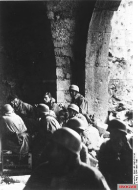 The German paratroopers inside the cloister after the destruction of the monastery.
