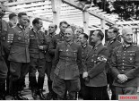 On 3 November 1942, a big delegation of Knight's Cross recipients visited the Reichsjugendführung, doing inspections of training places and communications with young Hitlerjugend members. This picture was taken when they met the HJ leader, Reichsjugendführer Artur Axmann. The identification as follow: (1) Oberleutnant Günter Klappich, (2) Hauptmann Erich Löffler, (3) Hauptmann Wilhelm Spindler, (4) Hauptmann Max Sachsenheimer, (5) Hauptmann Hans-Gotthard Pestke, (6) Generalleutnant Friedrich Herrlein, (7) Oberleutnant der Reserve Richard Grünert, (8) Oberleutnant Peter Kiesgen, (9) unidentified, (10) Reichsjugendführer Artur Axmann, (11) Oberleutnant Hans Guhr, and (12) Generalmajor Friedrich-Jobst Volckamer von Kirchensittenbach.