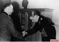 Reichsführer-SS Heinrich Himmler (Oberbefehlshaber Heeresgruppe Oberrhein) awarded the Ritterkreuz des Eisernen Kreuzes mit Eichenlaub #535 to Oberleutnant der Reserve Otto Carius from schwere Panzer-Abteilung 502. The picture was taken by SS-Kriegsberichter Ege on 2 January 1945 at the outskirts of Salzburg, Austria.