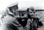 Major Wilhelm Knetsch (Kommandeur Infanterie-Regiment 545 / 389.Infanterie-Division) receives the Ritterkreuz des Eisernen Kreuzes (Knight's Cross of the Iron Crosses) from General der Panzertruppe Friedrich Paulus (Oberbefehlshaber 6. Armee). Stalingrad, 15 October 1942.