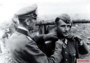 Major Wilhelm Knetsch (Kommandeur Infanterie-Regiment 545 / 389.Infanterie-Division) receives the Ritterkreuz des Eisernen Kreuzes (Knight's Cross of the Iron Crosses) from General der Panzertruppe Friedrich Paulus (Oberbefehlshaber 6. Armee). Stalingrad, 15 October 1942.