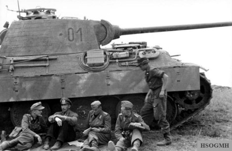 """Oakleaf bearer Colonel Willi Langkeit (2nd from left), with officers in front of a command panzer V Panther, turret number """"01"""", of the """"Großdeutschland"""" division, Army Group Southern Ukraine, Southern Soviet Union, May 1944."""