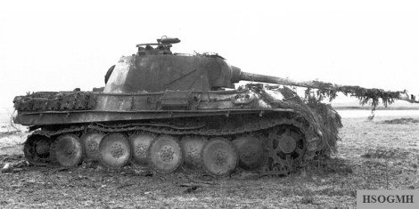 Burnt out Panther Ausf.G at the Battle of the Bulge, penetrated in the sponson.