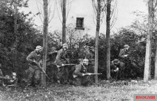 A German infantry battalion on alert as they search the suburbs of Arnhem for Allied troops.