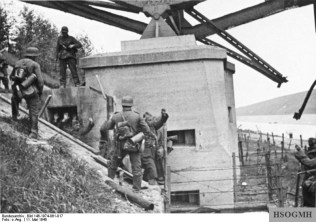 German troops take 30 prisoners from the bunker under the south side of the Veldwezelt bridge over the Albert Canal 11th May 1940 at 10am.