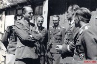 """Visit of Reichsminister Dr. Albert Speer to the base of Sturzkampfgeschwader 2 (StG 2) """"Immelmann"""", which is one of a series of events from the Speer visit session to the Eastern Front which took place from 14 to 18 June 1943. From left to right: unknown, Dr. Albert Speer , Hauptmann Walter Krauß ,Oberleutnant Steffen """"Egbert"""" Jaeckel, Hauptmann Alwin Boerst, Major Dr.jur. Ernst Kupfer, and Hauptmann Hans-Ulrich Rudel."""